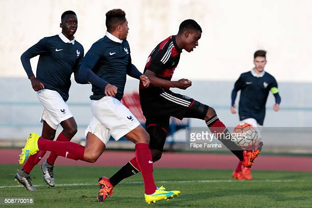 Alexandre Nsakala of France challenges CharlesJesaja Herrmann of Germany during the UEFA Under16 match between U16 France v U16 Germany on February 6...