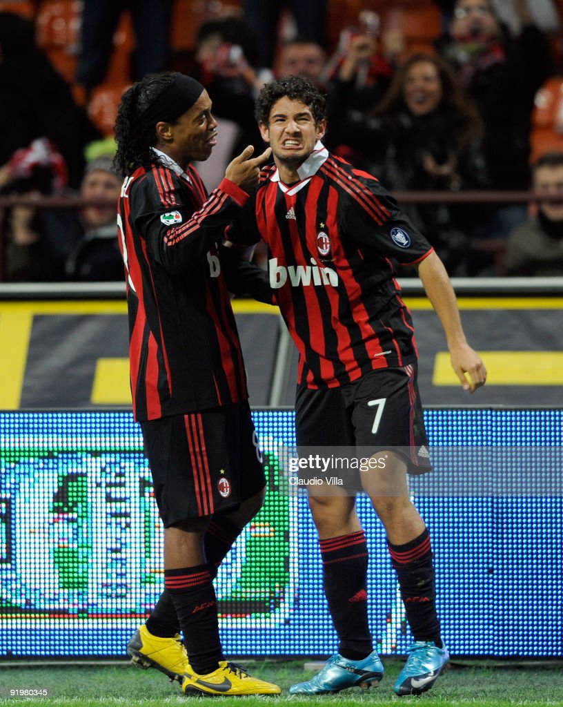 Alexandre Pato and <a gi-track='captionPersonalityLinkClicked' href=/galleries/search?phrase=Ronaldinho&family=editorial&specificpeople=202667 ng-click='$event.stopPropagation()'>Ronaldinho</a> of AC Milan celebrate after Milan's second goal during the Serie A match between AC Milan and AS Roma at Stadio Giuseppe Meazza on October 18, 2009 in Milan, Italy.