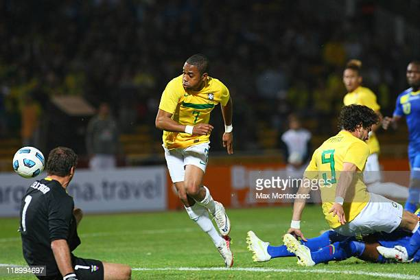 Alexandre Pato from Brazil fights for the ball to score the third goal during a match between Brazil and Ecuador as part of the Group B of the Copa...