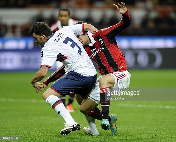 Alexandre Pato of AC Milan and Cesare Bovo of Genoa CFC during the Serie A match between AC Milan and Genoa CFC at San Siro Stadium on October 27...