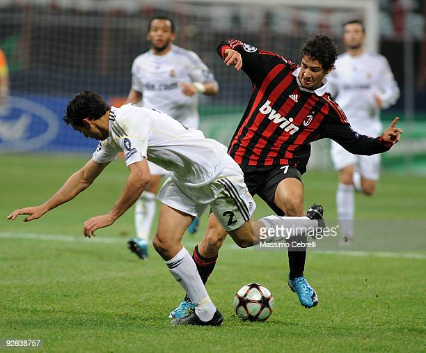 Alexandre Pato of AC Milan battles for the ball against Alvaro Arbeloa of Real Madrid during the UEFA Champions League group C match between AC Milan...