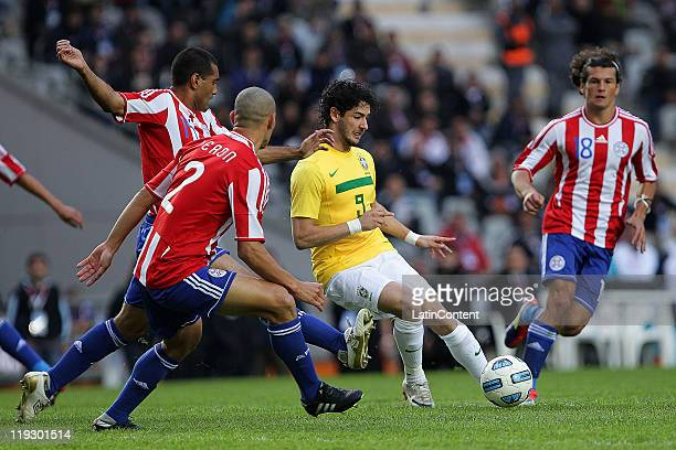 Alexandre Pato of Brazil struggles for the ball with players of Paraguay during a quarter final match between Brazil and Paraguay as part of the Copa...