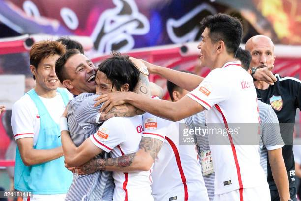 Alexandre Pato of Tianjin Quanjian celebrates a point with his head coach Fabio Cannavaro during the 19th round match of 2017 Chinese Football...
