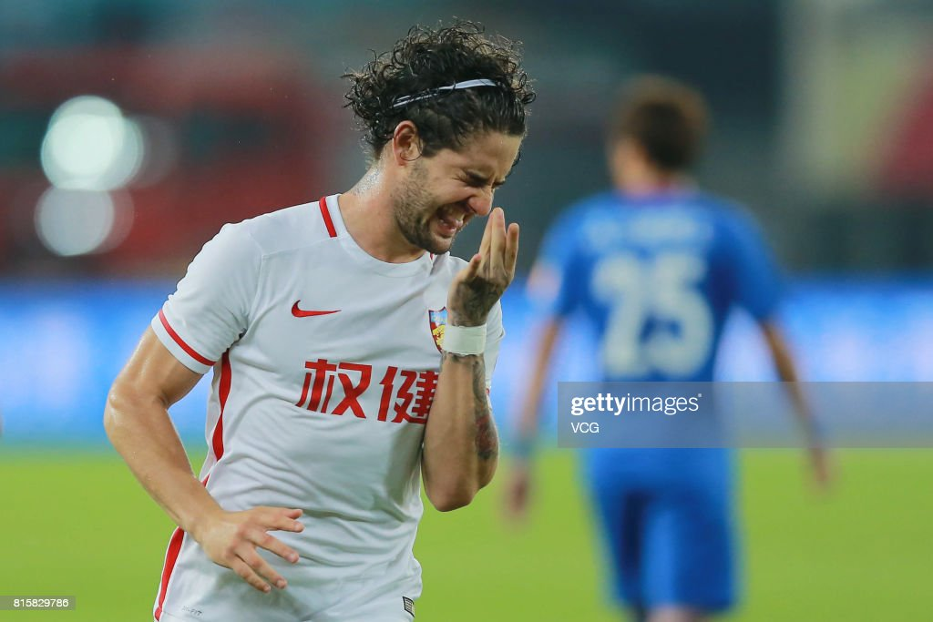 Alexandre Pato #10 of Tianjin Quanjian celebrates after scoring his team's third goal during the 17th round match of 2017 Chinese Football Association Super League (CSL) between Tianjin Quanjian and Shanghai Shenhua at Haihe Educational Football Stadium on July 16, 2017 in Tianjin, China.