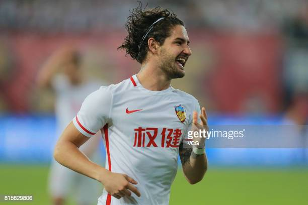 Alexandre Pato of Tianjin Quanjian celebrates after scoring his team's third goal during the 17th round match of 2017 Chinese Football Association...