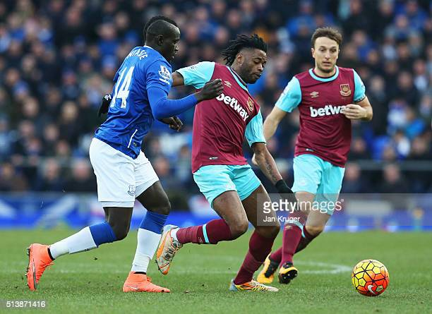 Alexandre Song of West Ham United and Oumar Niasse of Everton compete for the ball during the Barclays Premier League match between Everton and West...