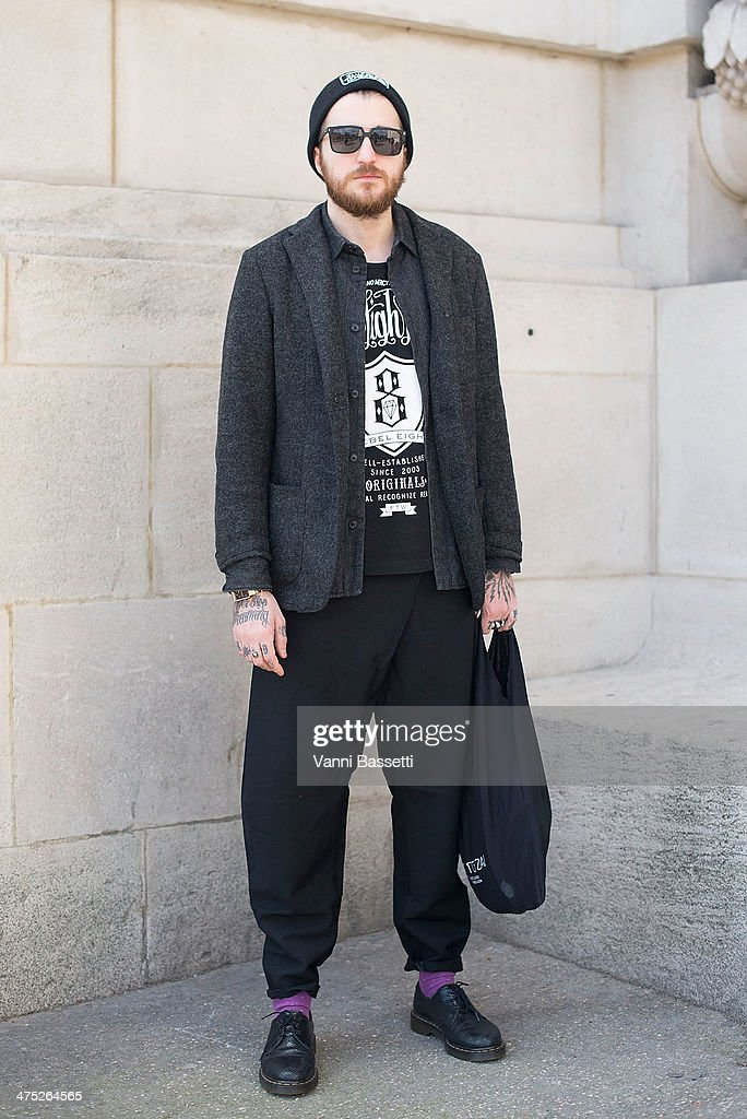 Alexandre Theallier poses wearing jacket and shirt by Closed, a Rebel 8 t-shirt and Dr. Martens shoes before Guy Laroche show on Day 2 of Paris Collections Womenswear Fall/Winter 2014-2015 at the Grand Palais on February 26, 2014 in Paris, France.