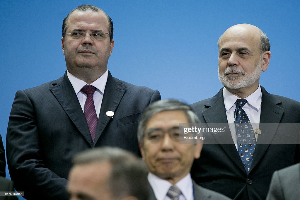 Alexandre Tombini, president of the central bank of Brazil, left, and Ben S. Bernanke, chairman of the U.S. Federal Reserve, arrive to a Group of 20 nations (G- 20) finance ministers and central bank governors family photograph on the sidelines of the International Monetary Fund (IMF) and World Bank Group Spring Meetings in Washington, D.C., U.S., on Friday, April 19, 2013. The G-20 economies reaffirmed a commitment to move more rapidly to market-determined currencies, while avoiding 'persistent exchange-rate misalignments.' Photographer: Andrew Harrer/Bloomberg via Getty Images