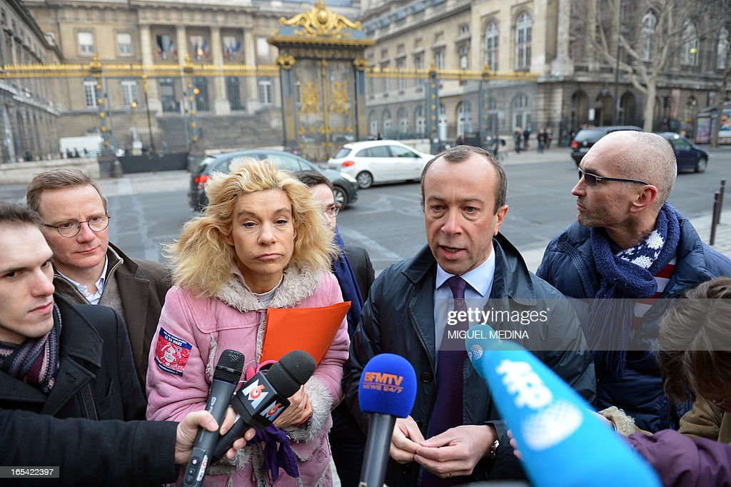 Alexandre Varaut (2ndR), lawyer of Anti gay marriage activist Virginie Tellene (3rdL), aka Frigide Barjot, representing the anti gay marriage association 'Manif pour tous !' (Demonstration for all !), speaks to journalists in front of the Paris courthouse on April 4, 2013, as they arrive to make a claim of defamation against French Socialist Party's (PS) Senator Jean-Pierre Michel, who has described them as 'the worst homophobic people'.