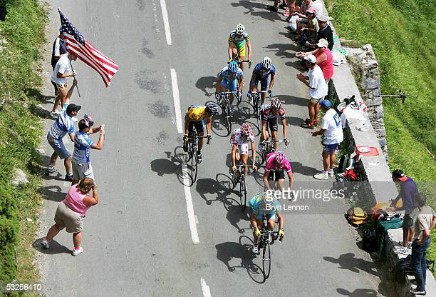 Alexandre Vinokourov of Kazakhstan and TMobile leads Jan Ullrich of Germany Mickael Rasmussen of Denmark Lance Armstrong of the USA and Ivan Basso...