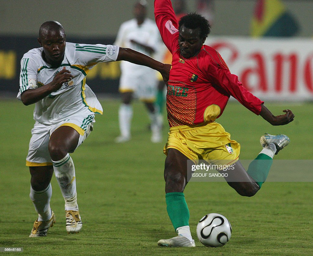 South African player Siboniso Gaxa vies with Guinean player Pablo Thiam during their Group C African Nations Cup football match at the Haras elHodoud...