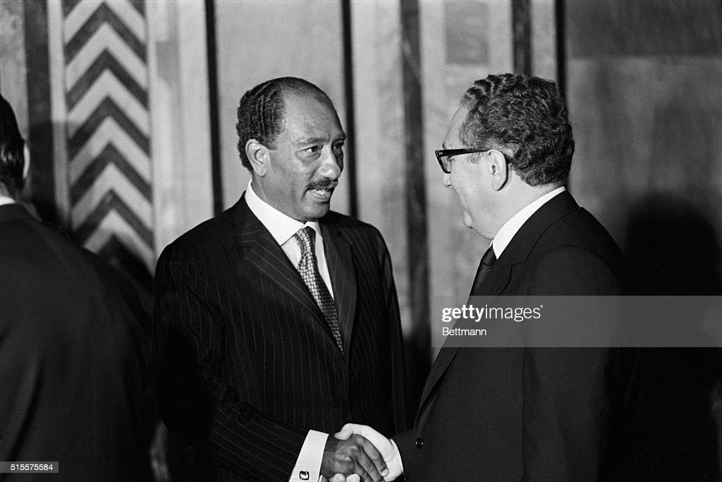 President Anwar Sadar shakes hands with US Secy. of State <a gi-track='captionPersonalityLinkClicked' href=/galleries/search?phrase=Henry+Kissinger&family=editorial&specificpeople=154883 ng-click='$event.stopPropagation()'>Henry Kissinger</a> as Kissinger goes through a receiving line at Ras-El-Tin palace hosted by President Nixon for Sadat 6/13. 6/13/1974