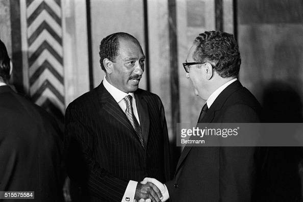 President Anwar Sadar shakes hands with US Secy of State Henry Kissinger as Kissinger goes through a receiving line at RasElTin palace hosted by...