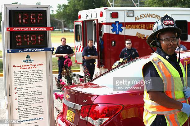 Alexandria Fire and EMS officials participate in a demonstration of the dangers of leaving children unattended in vehicles during a news conference...