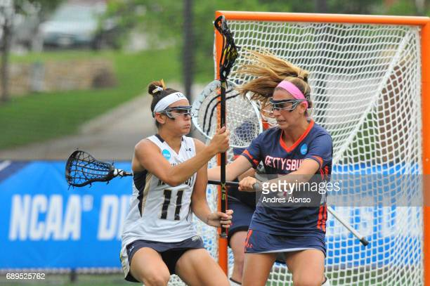 Alexandria Fitzpatrick of College of New Jersey is defended by Ali Gorab of Gettysburg College during the Division III Women's Lacrosse Championship...
