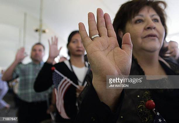 Resident aliens of US take their oath of citizenship during a naturalization ceremony at George Washington's Mount Vernon in Alexandria Virginia 22...
