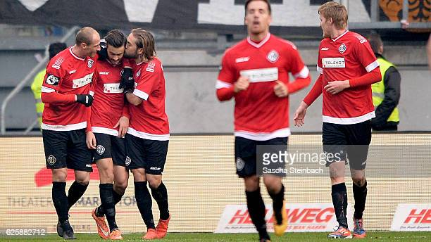Alexandros Kartalis of Aalen celebrates with team mates after scoring his team's second goal during the 3 Liga match between MSV Duisburg and VfR...