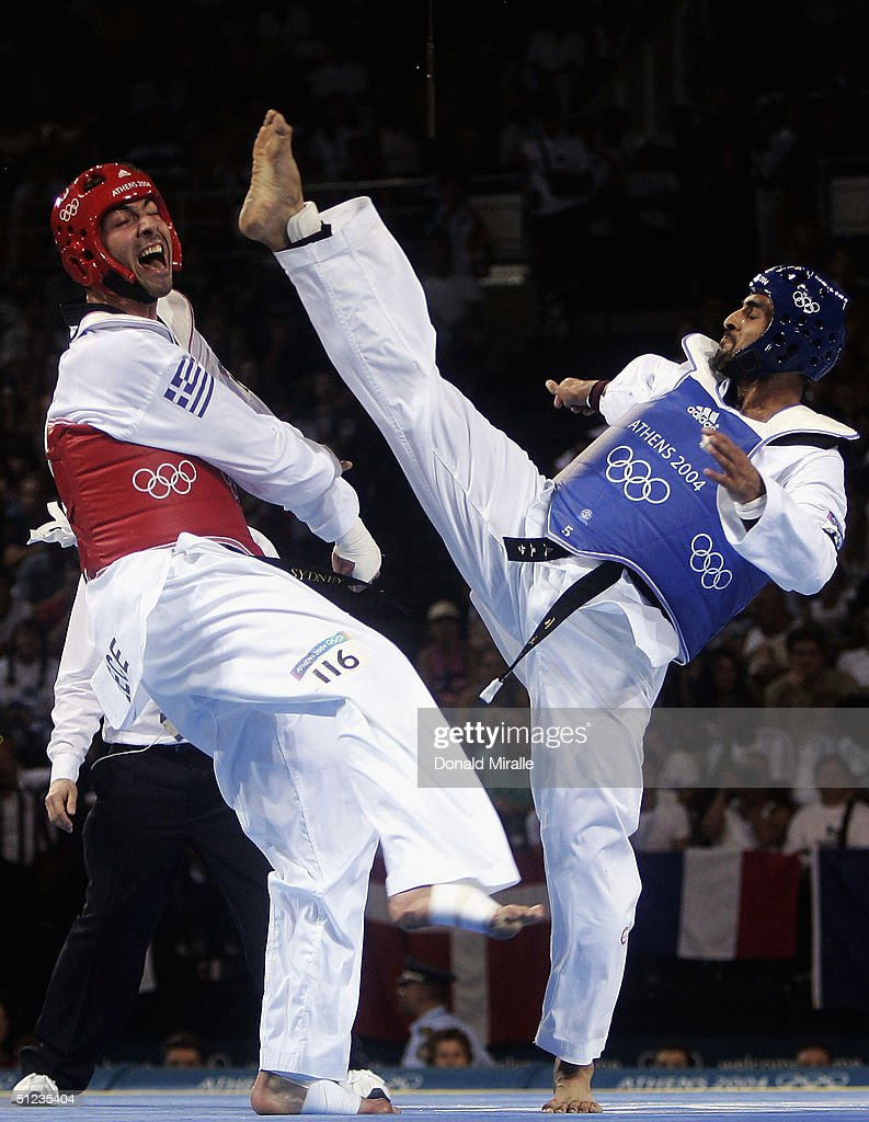 Alexandros Nikolaidis of Greece competes against Abdelkader Zrouri of Morroco in the men's over 80 kg Taekwondo semifinal match on August 29, 2004 during the Athens 2004 Summer Olympic Games at the Sports Pavilion part of the Faliro Coastal Zone Olympic Complex.
