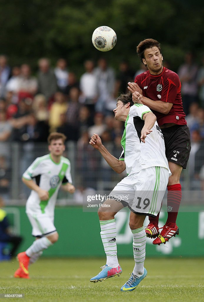 Alexandros Panagiotidis (R) of Hannover and Oskar Zawada of Wolfsburg compete for the ball during the A Juniors Bundesliga Semi Final at Beekestadium on June 11, 2014 in Hanover, Germany.