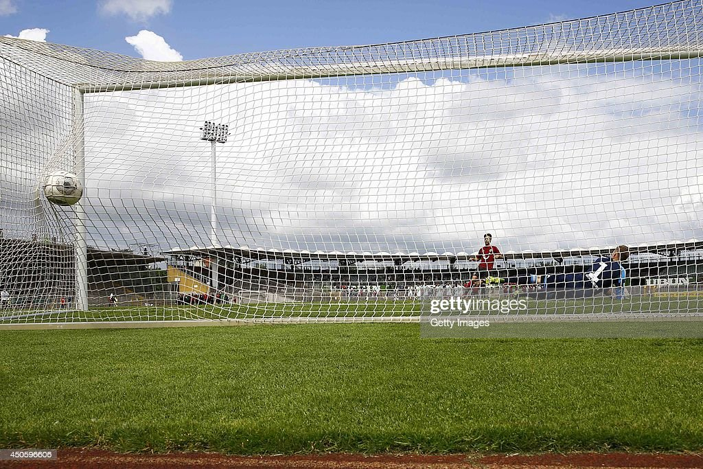 Alexandros Panagiotidis of Hannover scores against Niklas Klinger of Wolfsburg during the A Juniors Bundesliga Semi Final between U19 VfL Wolfsburg and U19 Hannover 96 at Stadion am Elsterweg on June 14, 2014 in Wolfsburg, Germany.