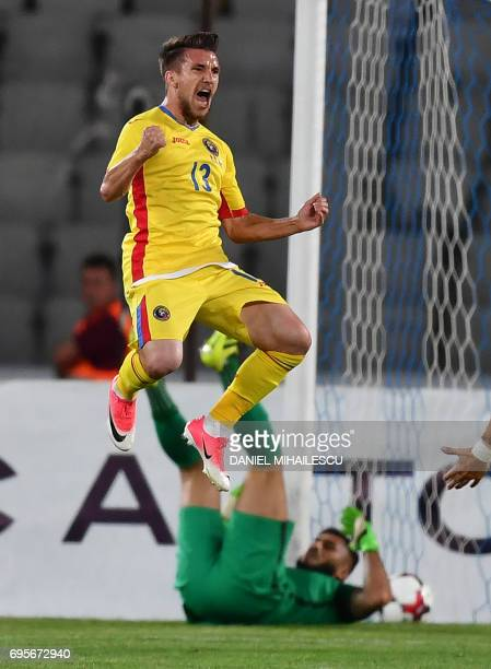 Alexandru Baluta of Romania celebrates after he scored 32 against Chile during their international friendly football matchbetween Romania and Chile...