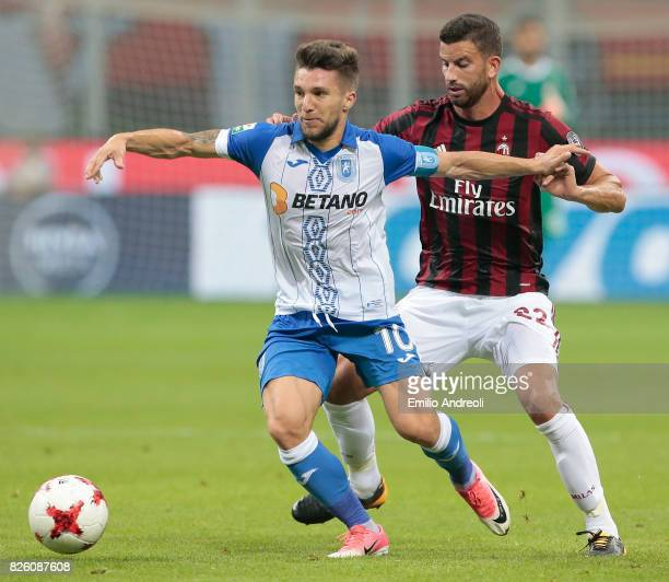 Alexandru Baluta of CS U Craiova competes for the ball with Mateo Pablo Musacchio of AC Milan during the UEFA Europa League Third Qualifying Round...