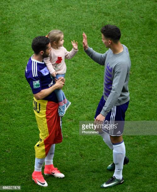 Alexandru Chipciu midfielder of RSC Anderlecht with his daughter and Leander Dendoncker midfielder of RSC Anderlecht celebrates winning the...