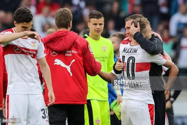 Alexandru Iulian Maxim of Stuttgart Head coach Hannes Wolf of Stuttgart celebrate their win during the Second Bundesliga match between VfB Stuttgart...