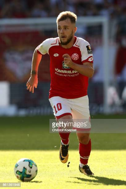 Alexandru Maxim of Mainz runs with the ball during the Bundesliga match between 1 FSV Mainz 05 and Hamburger SV at Opel Arena on October 14 2017 in...