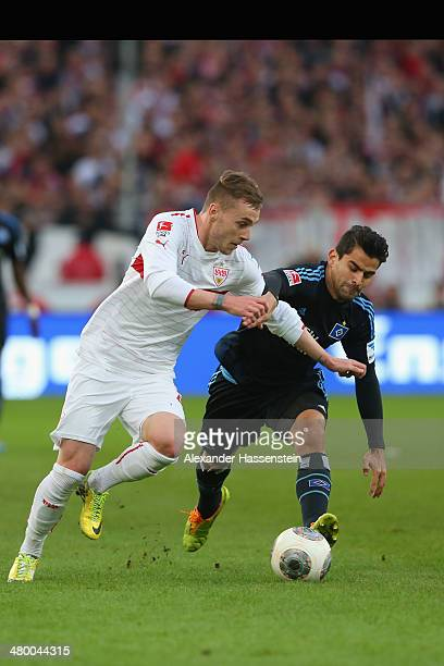 Alexandru Maxim of Stuttgart battles for the ball with Hernandez Rincon of Hamburg during the Bundesliga match between VfB Stuttgart and Hamburger SV...