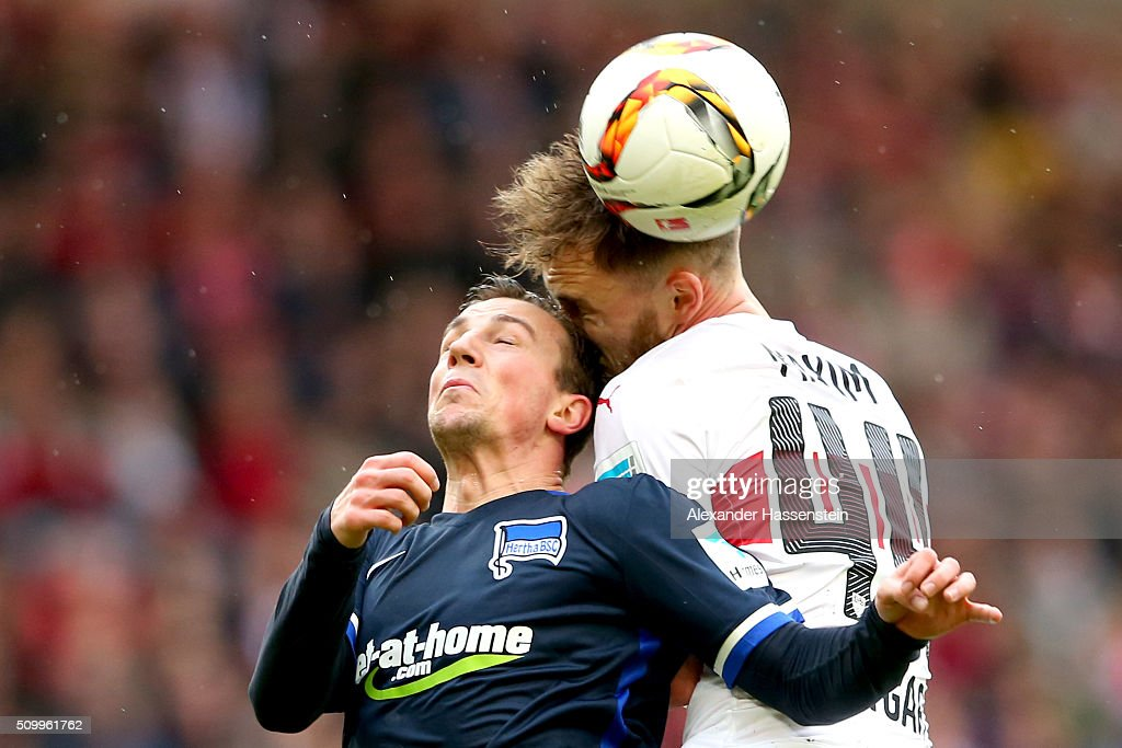 Alexandru Maxim of Stuttgart battles for the ball with Vladimir Darida of Hertha during the Bundesliga match between VfB Stuttgart and Hertha BSC...