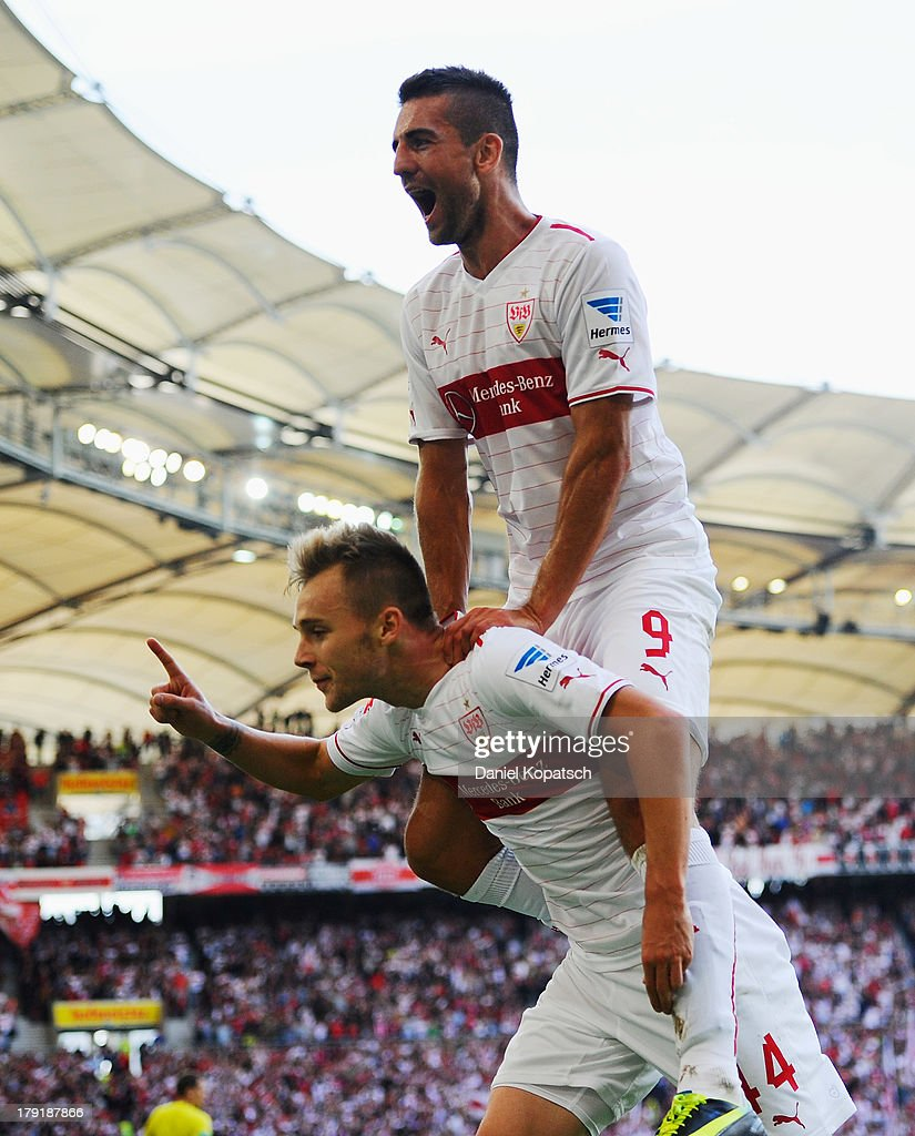Alexandru Maxim (L) of Stuttgart celebrates scoring his team's third goal with team-mate Vedad Ibisevic during the Bundesliga match between VfB Stuttgart and 1899 Hoffenheim at Mercedes-Benz Arena on September 1, 2013 in Stuttgart, Germany.