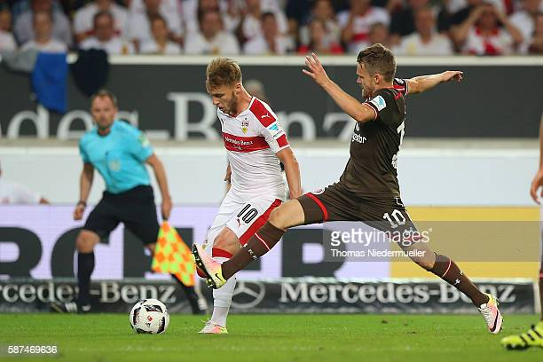 Alexandru Maxim of Stuttgart fights for the ball with Christopher Buchtmann of St Pauliduring the Second Bundesliga match between VfB Stuttgart and...