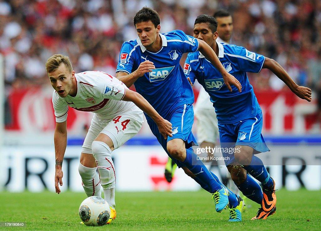 Alexandru Maxim of Stuttgart (L) is challenged by Tobias Strobl of Hoffenheim during the Bundesliga match between VfB Stuttgart and 1899 Hoffenheim at Mercedes-Benz Arena on September 1, 2013 in Stuttgart, Germany.
