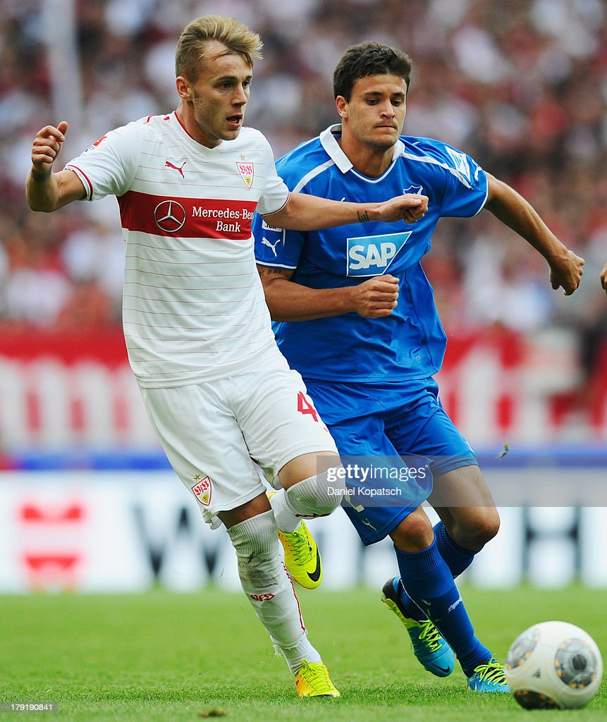 Alexandru Maxim of Stuttgart (L) is challenged by Tobias Strobl of Hoffenheim during the Bundesliga match between VfB Stuttgart and 1899 Hoffenheim at Mercedes-Benz Arena on September 1, 2013 in Stuttgart, Germany.