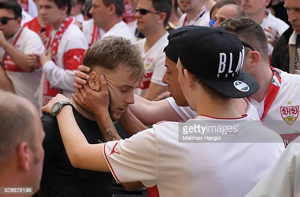 Alexandru Maxim of Stuttgart is held by fans after the Bundesliga match between VfB Stuttgart and 1 FSV Mainz 05 at MercedesBenz Arena on May 7 2016...