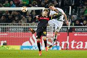 Alexandru Maxim of Stuttgart jumops for a header against Andreas Christensen of Moenchengladbach during the Bundesliga match between Borussia...