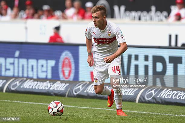 Alexandru Maxim of Stuttgart runs with the ball during the Bundesliga match between VfB Stuttgart and 1 FC Koeln at MercedesBenz Arena on August 30...