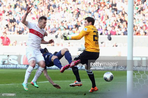 Alexandru Maxim of Stuttgart scores his team's first goal against Emin Bicakcic and goalkeeper Daniel Davari of Braunschweig during the Bundesliga...