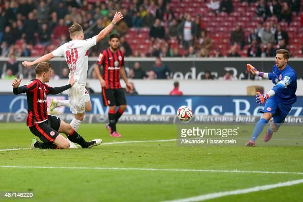 Alexandru Maxim of Stuttgart scores the 3rd team goal against Kevin Trapp keeper of Frankfurt during the Bundesliga match between VfB Stuttgart and...
