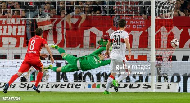 Alexandru Maxim of Stuttgart scores the first goal for his team against Daniel Mesenhoeler of Berlin during the Second Bundesliga match between VfB...