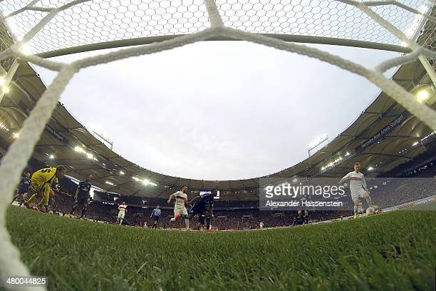Alexandru Maxim of Stuttgart scores the opening goal against Rene Adler keeper of Hamburg during the Bundesliga match between VfB Stuttgart and...