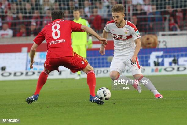 Alexandru Maxim of Stuttgart Stephan Fuerstner of Union Berlin battle for the ball during the Second Bundesliga match between VfB Stuttgart and 1 FC...