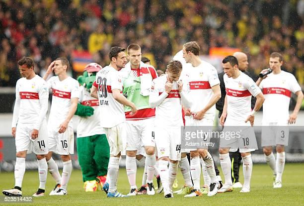 Alexandru Maxim of VfB Stuttgart and team mates are dejected after the Bundesliga match between VfB Stuttgart and Borussia Dortmund at MercedesBenz...
