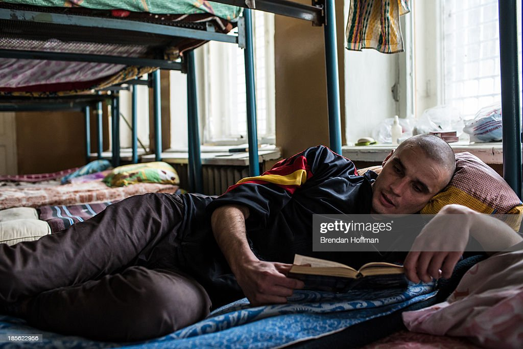 Alexei, a 29-year-old from Chelyabinsk who is addicted to a methamphetamines, reads a book during the first stage of his treatment for drug addiction at City Without Drugs on October 16, 2013 in Yekaterinburg, Russia. City Without Drugs is a well-known narcotics treatment program in Russia founded by Yevgeny Roizman, who was elected mayor of Yekaterinburg in September 2013.