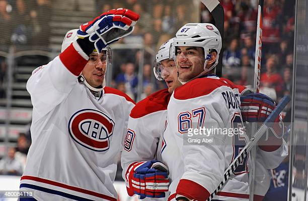 Alexei Emelin Andrei Markov and Max Pacioretty of the Montreal Canadiens celebrate a first period goal during NHL game action against the Toronto...