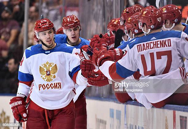 Alexei Emelin of Team Russia high fives the bench after a second period goal against Team North America during the World Cup of Hockey 2016 at Air...