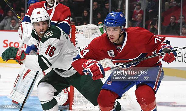 Alexei Emelin of the Montreal Canadiens and Jason Zucker of the Minnesota Wild battle for position in the NHL game at the Bell Centre on November 8...