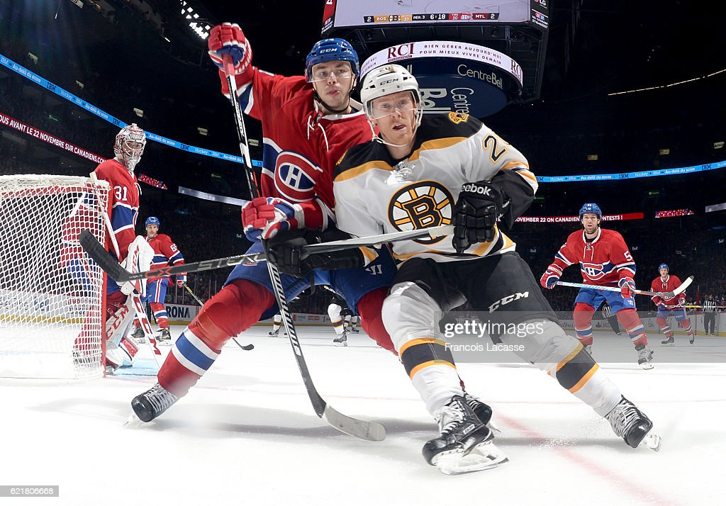 Alexei Emelin #74 of the Montreal Canadiens and Riley Nash #20 of the Boston Bruins battle for position in the NHL game at the Bell Centre on November 8, 2016 in Montreal, Quebec, Canada.