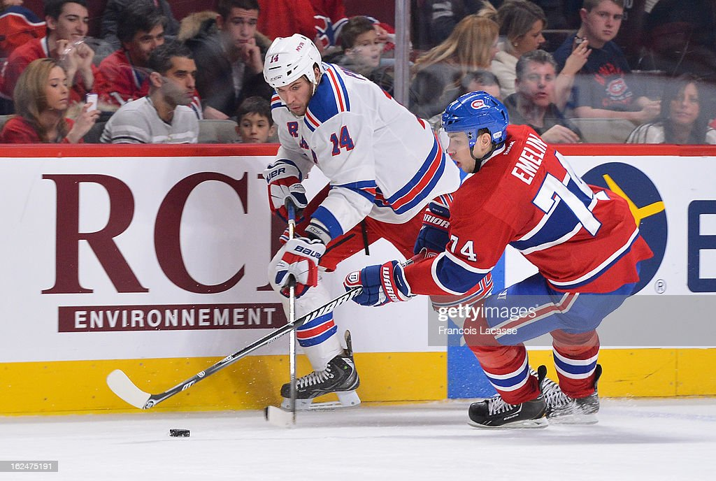 <a gi-track='captionPersonalityLinkClicked' href=/galleries/search?phrase=Alexei+Emelin&family=editorial&specificpeople=723573 ng-click='$event.stopPropagation()'>Alexei Emelin</a> #74 of the Montreal Canadiens battles for the puck with <a gi-track='captionPersonalityLinkClicked' href=/galleries/search?phrase=Taylor+Pyatt&family=editorial&specificpeople=204508 ng-click='$event.stopPropagation()'>Taylor Pyatt</a> #14 of the New York Rangers during the NHL game on February 23, 2013 at the Bell Centre in Montreal, Quebec, Canada.